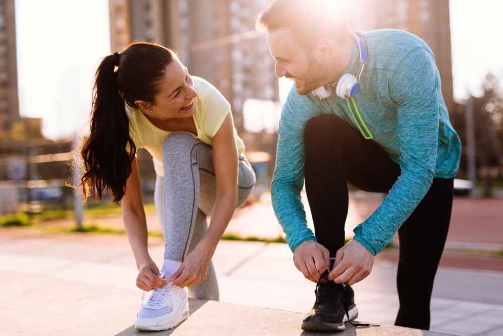 happy-couple-workout-morning-sun