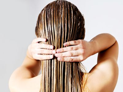 woman-applying-conditioner-on-hair 10200